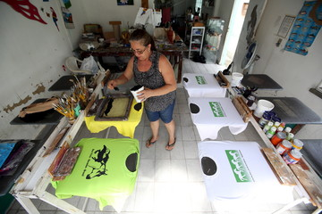 Ira Almeida prints t-shirts with an image of wild horses in her studio in the Amazon city of Boa Vista in the state of Roraima
