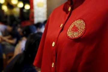 A Hello Kitty image is seen on the uniform of a waitress at a Hello Kitty-themed Chinese restaurant in Hong Kong