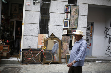 A man walks past a shop at Rastro market, a second hand market in central Madrid