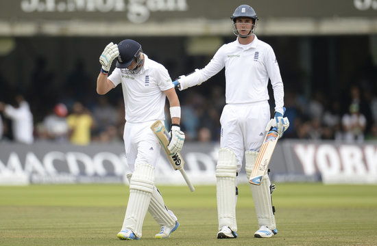 England's Root leaves field after being dismissed as Broad looks on during second cricket test match at Lord's cricket ground in London