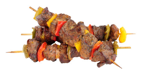 Grilled lamb meat and sweet pepper kebabs isolated on a white background