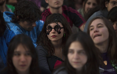 Students take part in a demonstration against proposed budget cuts in public education at central Madrid