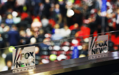 The logos of Fox News Channel are seen engraved on the glass of one of their booths at the Republican National Convention in Cleveland
