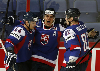 Slovakia's Radivojevic celebrates his goal against Russia with Sekera and Kopecky during their 2013 IIHF Ice Hockey World Championship preliminary round match at the Hartwall Arena in Helsinki
