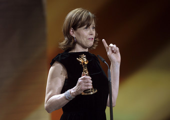 U.S. actress Weaver holds her trophy during 48th Golden Camera award ceremony in Berlin