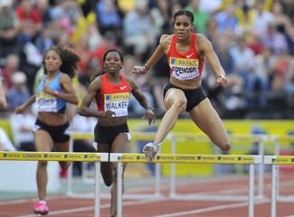 Jamaica's Kaliese Spencer clears a hurdle before winnning the women's 400m hurdles during the London Grand Prix, Diamond League, athletics meeting in London