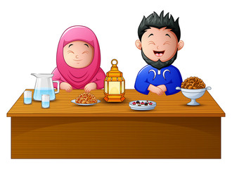 Happy muslim couple break fasting together