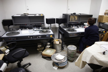 A woman works on repairing reels of film inside the Yugoslav Film Archive in Belgrade