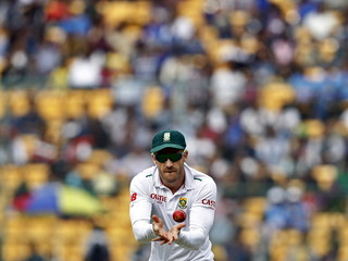 South Africa's Plessis prepares to catch the ball on the first day of their second cricket test match against India in Bengaluru