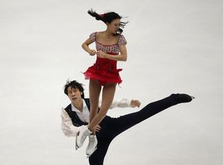 China's Pang Qing and Tong Jian perform at the pairs free skating programme during ISU Grand Prix of Figure Skating in Beijing