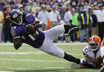 Baltimore Ravens Brown eludes the grasp of Cleveland Browns Owens for touchdown in their NFL football game in Baltimore