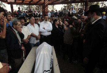 Family members and friends mourn during the funeral of Morag in the Israeli town of Caesarea