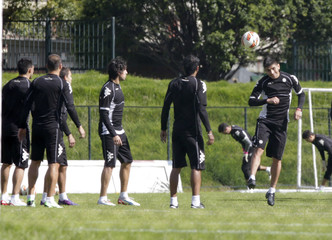 Players from Paraguay's Olimpia train during a soccer practice session in Bogota