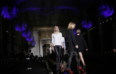 Model Karlie Kloss walks the runway during a rehearsal of Italian designer Donatella Versace's Haute Couture Spring Summer 2015 fashion show in Paris
