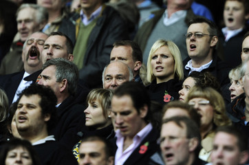Britain's Zara Phillips stands in the crowd as England take on Australia during their international friendly rugby match in London