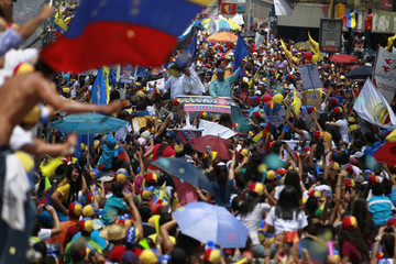 Venezuela's opposition leader and presidential candidate Capriles greets supporters during a campaign rally in the state of Guarico
