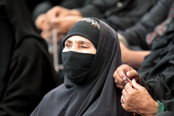 A woman attends an anti-government rally in Sanaa