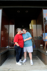 Rudd and Lambert stand in front of Lambert's art gallery in Buffalo