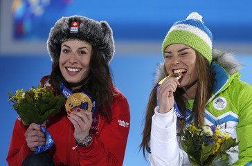 Joint gold medalists Switzerland's Gisin and Slovenia's Maze pose during the medal ceremony for the women's alpine skiing downhill race at the Sochi 2014 Winter Olympic Games in Sochi