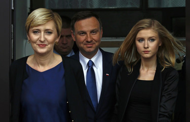 Presidential candidate of the Law and Justice Party Duda leaves a polling station with his wife Agata and daughter Kinga in Krakow