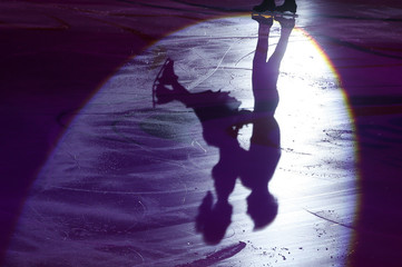 Russia's Astakhova and Rogonov cast shadows on ice as they perform during the exhibition gala at the Rostelecom Cup ISU Grand Prix of Figure Skating in Moscow