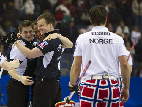Scotland's skip Brewster celebrates with teammates as Norway's skip Ulsrud leaves the ice following the semi-finals at the World Men's Curling Championships in Regina
