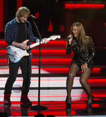 """Singers Beyonce and Sheeran perform a medley during the taping of """"Stevie Wonder: Songs In The Key Of Life - An All-Star GRAMMY Salute"""" concert at Nokia theatre in Los Angeles"""