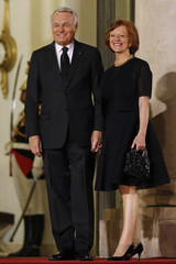 French Prime Minister Jean-Marc Ayrault and his wife Brigitte arrive to attend a State Dinner at the Elysee Palace in Paris