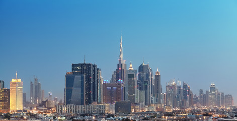 Dubai city downtown at dusk, United Arab Emirates.