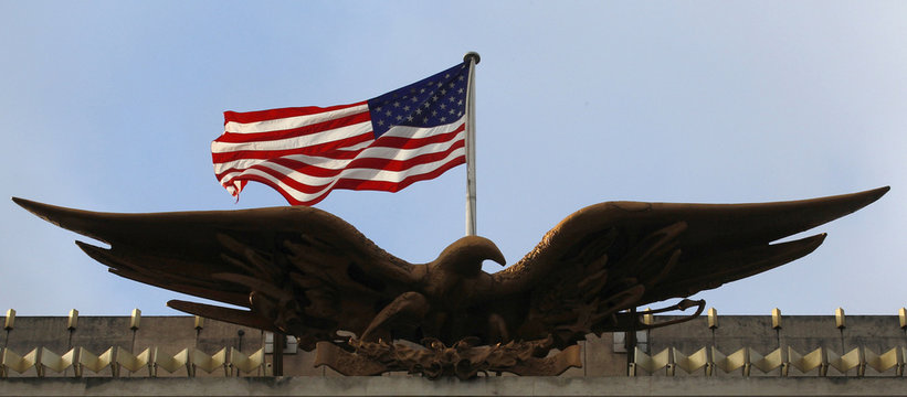 A stars and stripes flies above an eagle on the United States embassy in central London