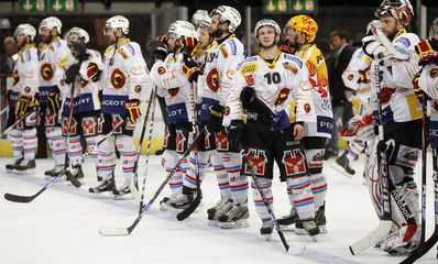 Team members of SC Bern stand on the rink after losing their Swiss ice hockey play-off game against ZSC Lion at the Hallenstadion arena in Zurich