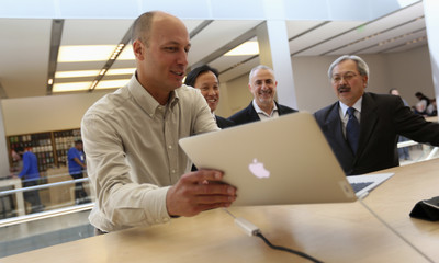 Apple Inc.'s Bridger talks with San Francisco city officials at Apple's flagship retail store in San Francisco