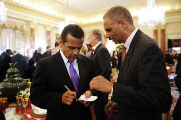 Villaraigosa talks with Holder as they arrive for a lunch in honor of Mexico's Calderon at the State Department in Washington