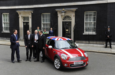 British Prime Minister Cameron and Business Secretary Cable meet BMW executives Reeithofer and Robertson in London