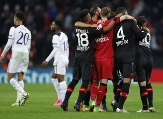 Bayer Leverkusen players celebrate at the end of the match