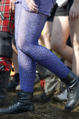 The shoes and stockings of a woman on her way to the 24th Wacken Open Air Festival are pictured in Wacken