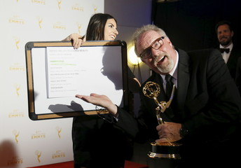 """Beers poses with a sign indicating him as one of the winners of the outstanding unstructured reality award as he holds his award for """"Deadliest Catch"""" backstage at the 2015 Creative Arts Emmy Awards in Los Angeles"""