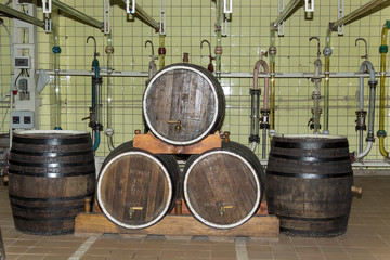 Old wine kegs in the factory for the production of champagne wine