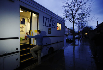 Clinical lead, doctor Al Story boards the mobile X-ray unit which is screening for TB (tuberculosis) in Ladbroke Grove in London