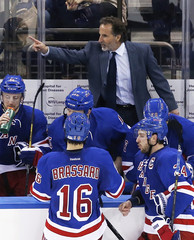 New York Rangers John Tortorella shouts at linesman as they play  Boston Bruins in Game 4 of their NHL playoff hockey series in New York