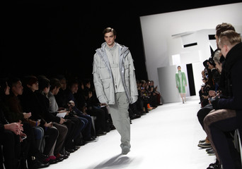 A model presents a creation from the Lacoste Autumn/Winter 2013 collection during New York Fashion Week