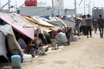 Displaced Iraqi people are seen at Debaga Camp