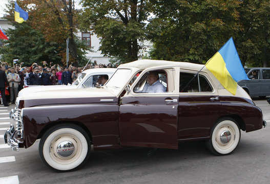Ukrainian President Viktor Yanukovich sits in a Pobeda (Victory) vintage car during a car rally from from St. Petersburg to Kiev, near the border town of Glukhov