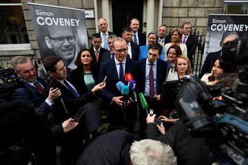 Irish Minister for Housing, Planning, Community and Local Government Simon Coveney speaks to journalists outside the Fine Gael headquarters in Dublin