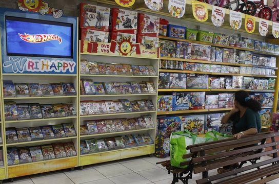 Customer looks at toys for a gift at Ri Happy store in Sao Paulo