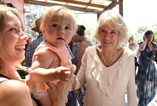 Camilla, Duchess of Cornwall meets Adeline Heuriz with her daughter Ayanna at Oranje Tractor Centre during a visit to Albany, Western Australia