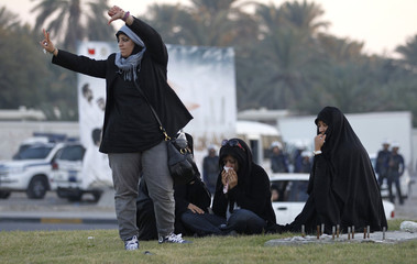 Zaynab al-Khawaja, the daughter of Human Rights activist, Abdulhadi al-Khawaja, wipes her eyes that are affected by tear gas during a sit-in at a roundabout in Budaiya Highway