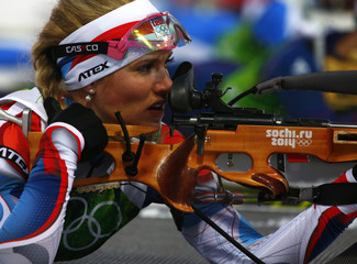 Soukalova of the Czech Republic aims during the mixed biathlon relay at the 2014 Sochi Winter Olympics
