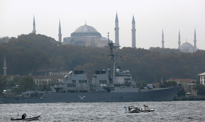 U.S. Navy guided-missile destroyer USS Ross, with the Byzantine-era monument of Hagia Sophia in the background, prepares to leave from the port in Istanbul