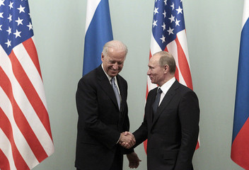 Russian Prime Minister Putin shakes hands with U.S. Vice President Biden during their meeting in Moscow